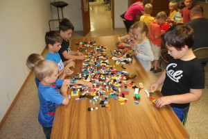 more kids playing with legos