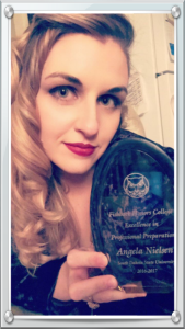 angela nielsen with award